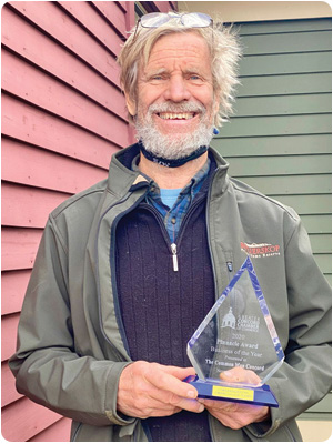 The Common Man President Alex Ray with the Greater Concord Chamber of Commerce's Business of the Year 2020 Pinnacle Award.