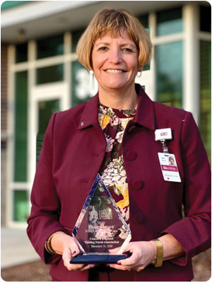 Concord Regional Visiting Nurse Association President and CEO Beth Slepian with the Greater Concord Chamber of Commerce's Nonprofit Business of the Year 2020 Pinnacle Award.