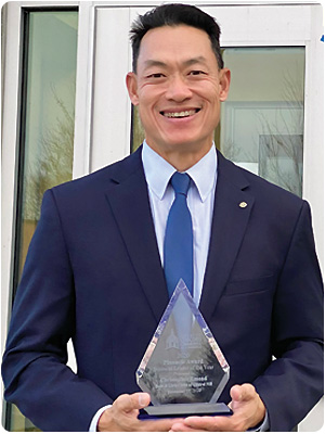 Boys and Girls Clubs of Central New Hampshire Executive Director Christopher Emond with the Greater Concord Chamber of Commerce's Business Leader of the Year 2020 Pinnacle Award.