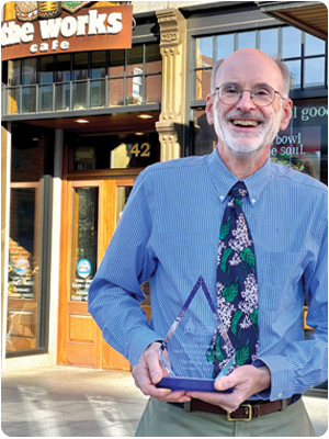 The Works Café Concord, NH Owner Don Brueggemann with the Greater Concord Chamber of Commerce's Small Business of the Year 2020 Pinnacle Award.