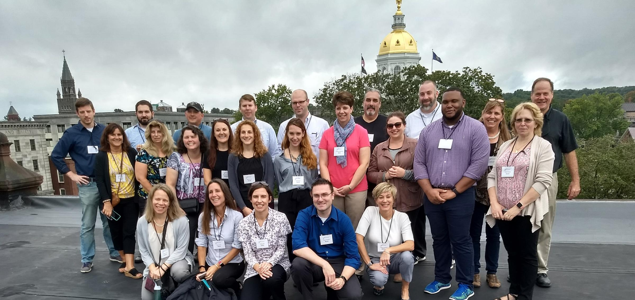 Leadership Greater Concord Class of 2019 poses on the roof of the Sheraton Building with Concord's iconic New Hampshire State House dome visible in the background. Participants spent History and Culture Day getting a historical overview of Concord and its cultural venues and opportunities from Concord City Councilor Jennifer Kretovic and property owner Mark Ciborowski.