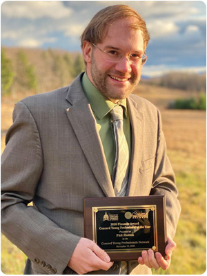 New Hampshire Fiscal Policy Institute Senior Policy Analyst Phil Sletten with the Greater Concord Chamber of Commerce's Concord Young Professional of the Year 2020 Pinnacle Award.